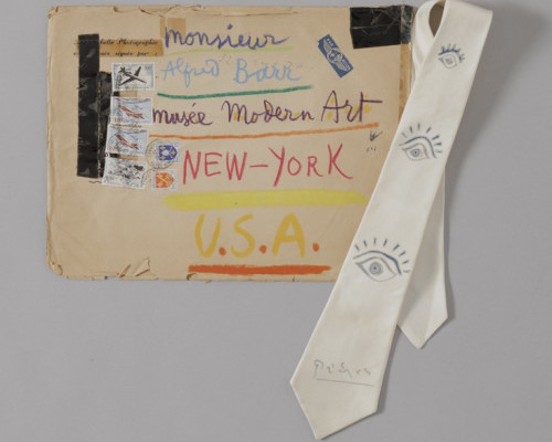 Hand-decorated envelope and tie sent by Pablo Picasso to MoMA director Alfred H. Barr, Jr.. 1957